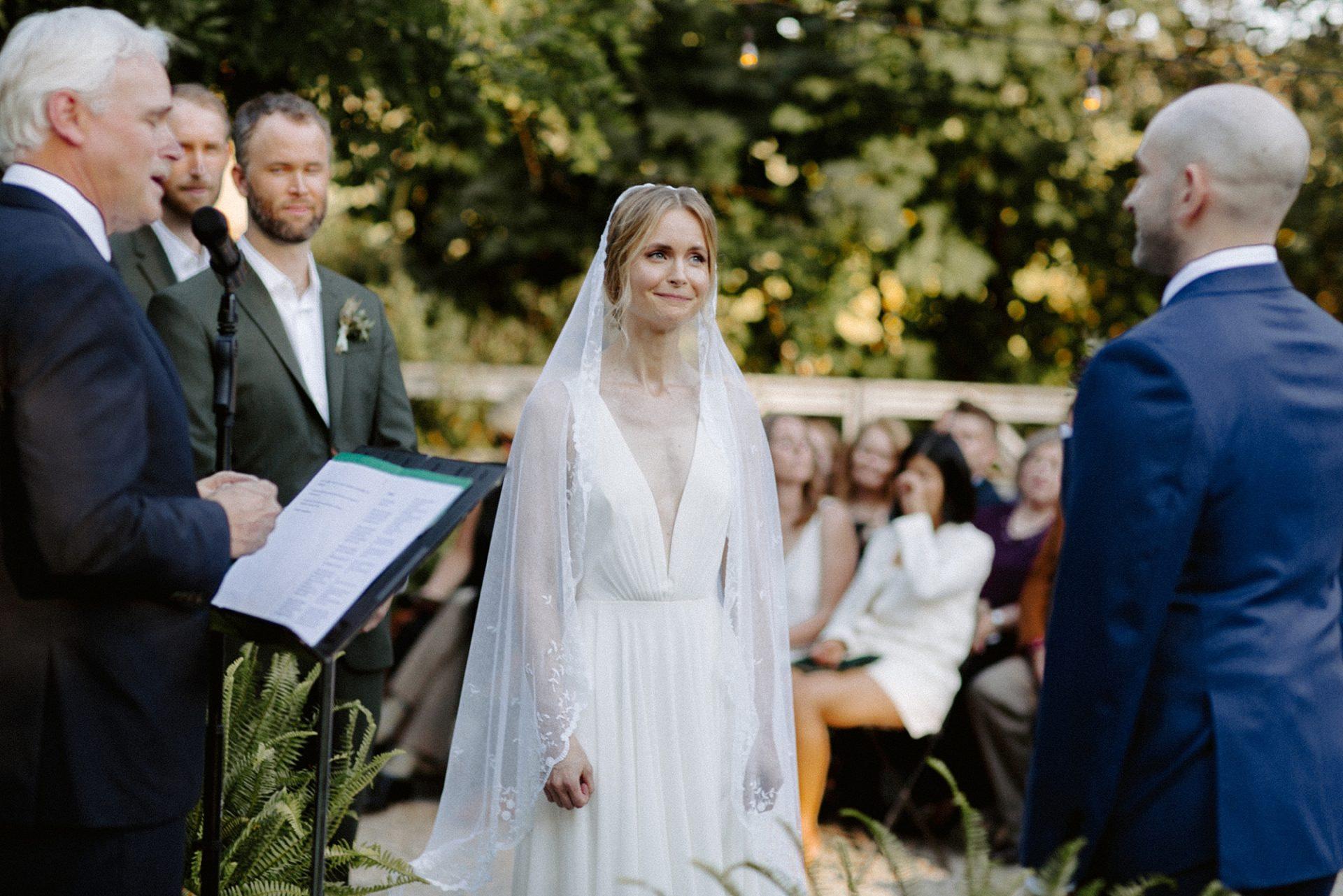 Bride looking at groom at M & D Farm