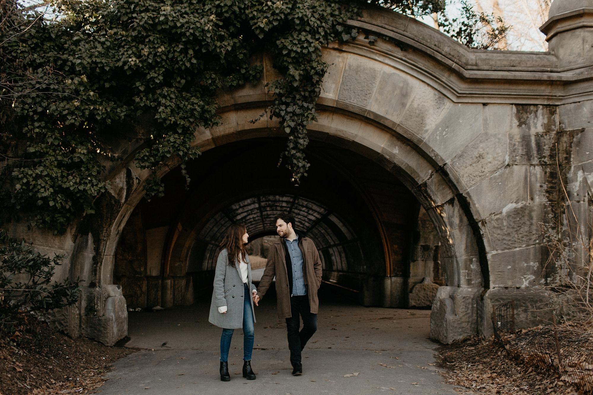couple walking under a bridge in prospect heights brooklyn
