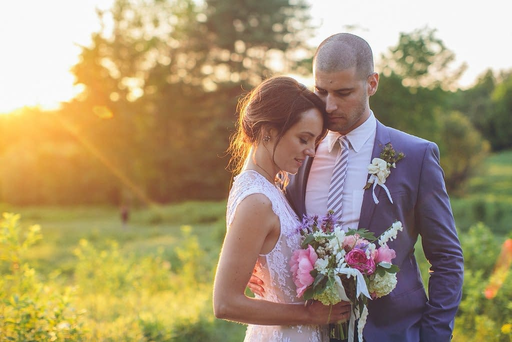 A simple summer bridal bouquet of June flowers in a neutral color palette by Nectar and Root, Vermont wedding florist at Alerin Barn in Saint Johnsbury, Vermont.