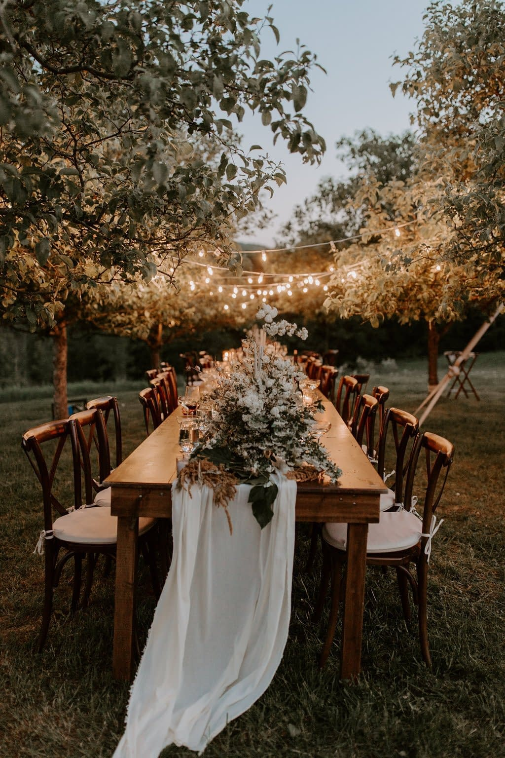 Outdoor elopement farm table flower and greenery runner reception centerpiece by Nectar and Root, Vermont wedding florist at a backyard wedding in Vermont.