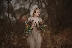 A lush spring bridal bouquet of April flowers in a moody color palette by Nectar and Root, Vermont wedding florist in Burlington, Vermont.