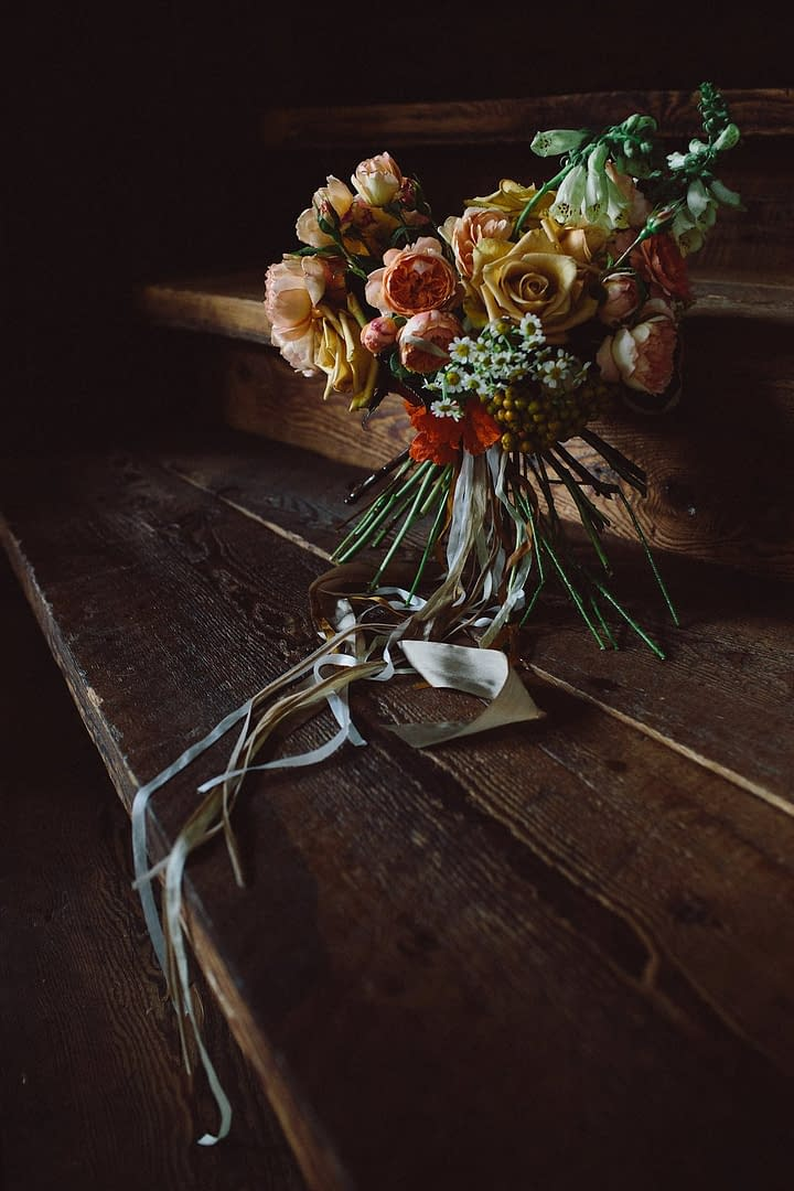 A boho summer bridal bouquet of July flowers in a neutral color palette by Nectar and Root, Vermont wedding Florist at Riverside Farm in Pittsfield, Vermont.