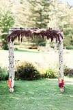 A boho fall floral arbor of September flowers in a moody color palette by Nectar and Root, Vermont wedding florist at Stowehof Inn in Stowe, Vermont.