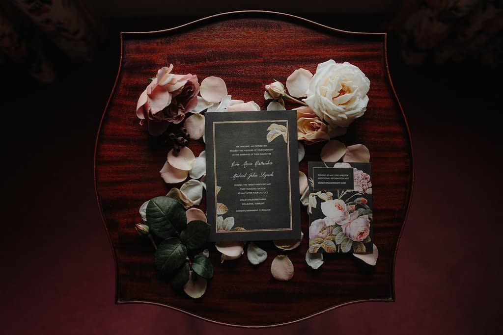 Intimate artful spring micro wedding mauve floral invitations on flat lay with May garden rose accents by Nectar and Root, Vermont wedding florist at the Inn at Shelburne Farms in Shelburne, Vermont.