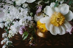 Yellow, pink and white centerpiece by Nectar and Root, Vermont wedding florist at Shelburne Coach Barn in Shelburne, Vermont.
