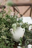 Lush neutral greenery centerpiece by Nectar and Root, Vermont wedding florist at Shelburne Museum in Shelburne, Vermont.