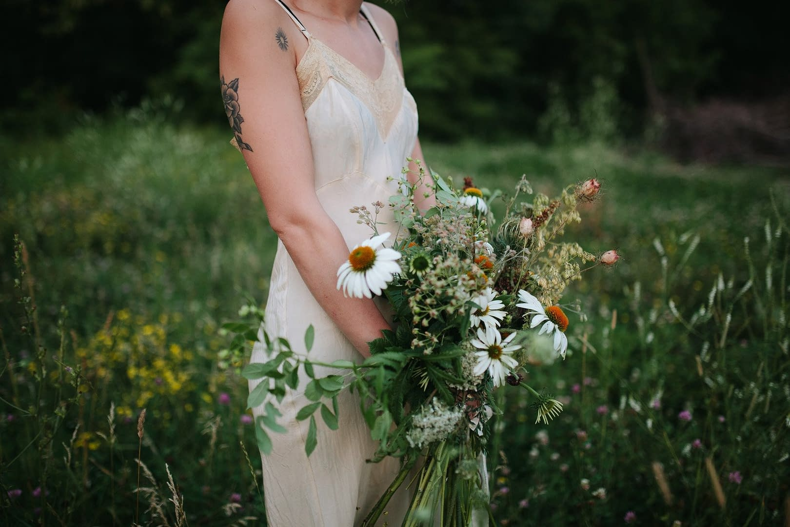 A boho summer bridal bouquet of August flowers in a neutral color palette by Nectar and Root, Vermont wedding florist.