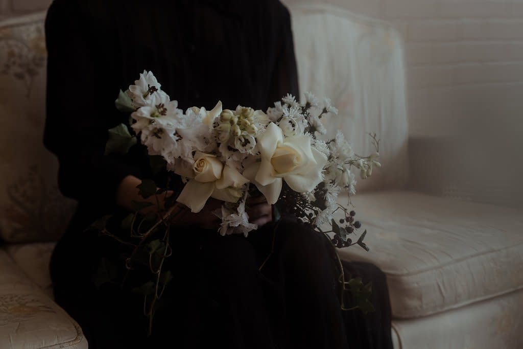 A modern fall bridal bouquet of November flowers in a moody color palette by Nectar and Root, Vermont wedding florist at Nectar and Root Studio in Winooski, Vermont.