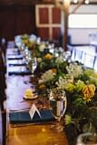 A lush summer reception centerpiece of July flowers in a neutral color palette by Nectar and Root, Vermont wedding Florist at Riverside Farm in Pittsfield, Vermont.