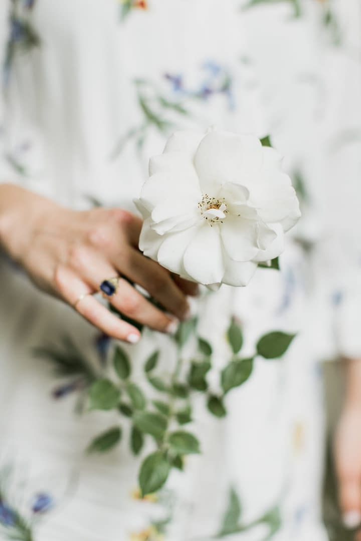 Seasonal white rose corsage by Nectar and Root, Vermont wedding florist at Shelburne Museum in Shelburne, Vermont.