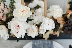 Spring peony centerpiece by Nectar and Root, Vermont wedding florist at Foxfire Mountain House in the Catskills, New York.