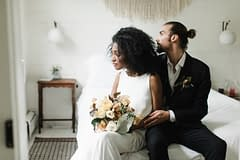 Bride and groom holding neutral bridal bouquet by Nectar and Root, Vermont wedding florist at Foxfire Mountain House in the Catskills, New York.