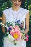 A boho summer bridal bouquet of June flowers in a neutral color palette by Nectar and Root, Vermont wedding florist at Alerin Barn in Saint Johnsbury, Vermont.