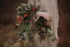 A boho spring bridal bouquet of April flowers in a moody color palette by Nectar and Root, Vermont wedding florist in Burlington, Vermont.