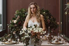 A simple winter bridal bouquet of February flowers in a moody color palette by Nectar and Root, Vermont wedding florist at Trapp Family Lodge in Stowe, Vermont.