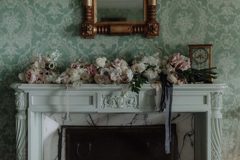 Intimate modern artful spring bridesmaids' bouquets of May blush peonies, anemones, and mauve garden roses on indoor reception mantle by Nectar and Root, Vermont wedding florist at the Inn at Shelburne Farms in Shelburne, Vermont.