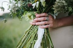 A lush summer bridal bouquet of August flowers in a neutral color palette by Nectar and Root, Vermont wedding florist.