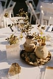 A lush fall reception centerpiece of September flowers in a neutral color palette by Nectar and Root, Vermont wedding florist at Coach Barn at Shelburne Farms in Shelburne, Vermont.