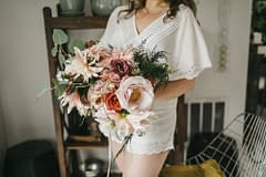 Artful sculptural fall micro wedding bridal bouquet featuring September ferns, garden roses, cafe au lait dahlias, eucalyptus, and blushing bride protea with pops of red by Nectar and Root, Vermont wedding florist at Foxfire Mountain House in Catskills, New York.