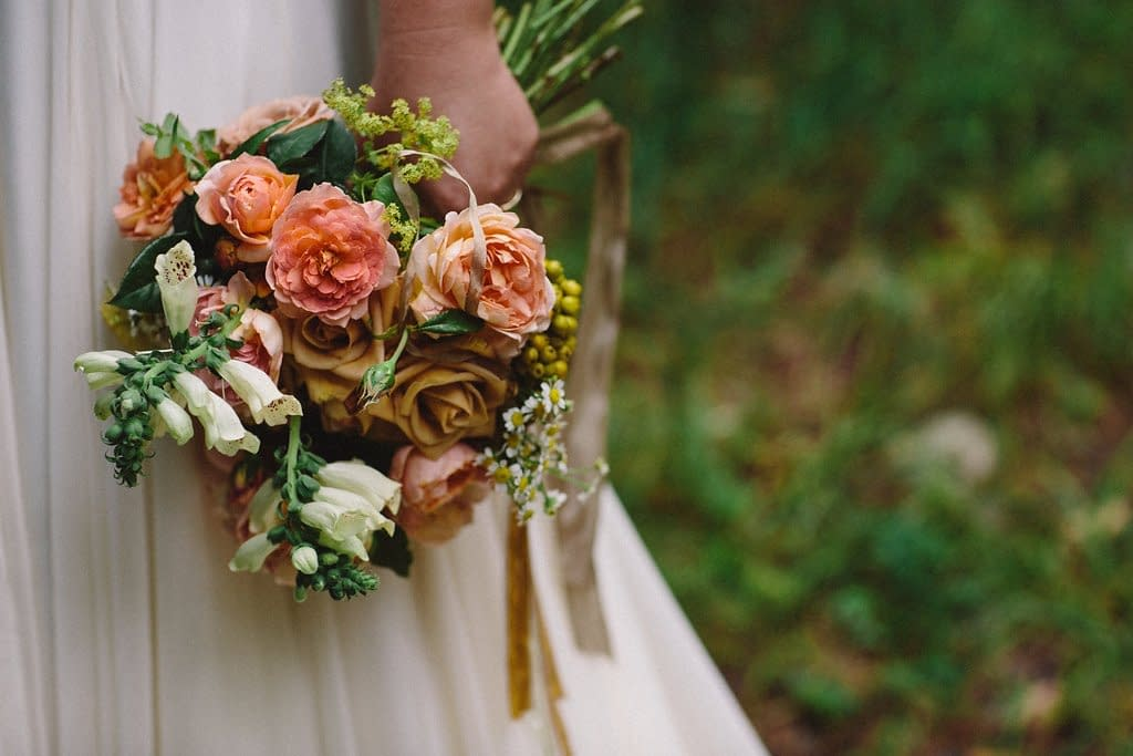 A modern summer bridal bouquet of July flowers in a neutral color palette by Nectar and Root, Vermont wedding Florist at Riverside Farm in Pittsfield, Vermont.