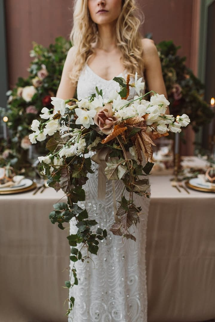 A lush winter bridal bouquet of February flowers in a moody color palette by Nectar and Root, Vermont wedding florist at Trapp Family Lodge in Stowe, Vermont.