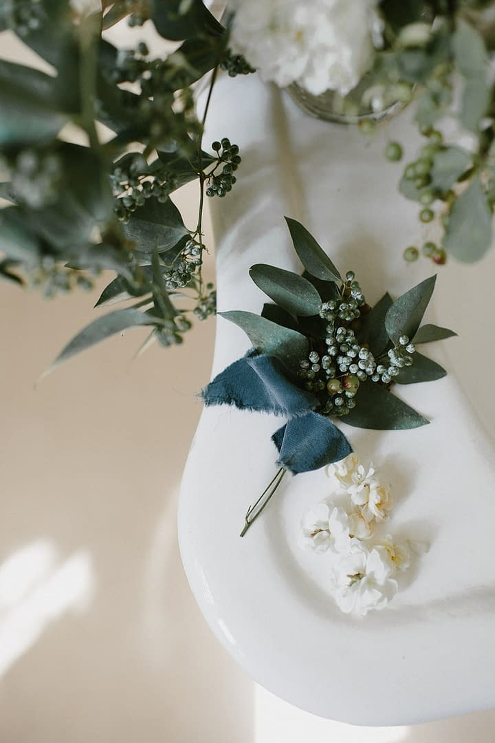 A lush fall floral accent of September flowers in a neutral color palette by Nectar and Root, Vermont wedding florist at Coach Barn at Shelburne Farms in Shelburne, Vermont.
