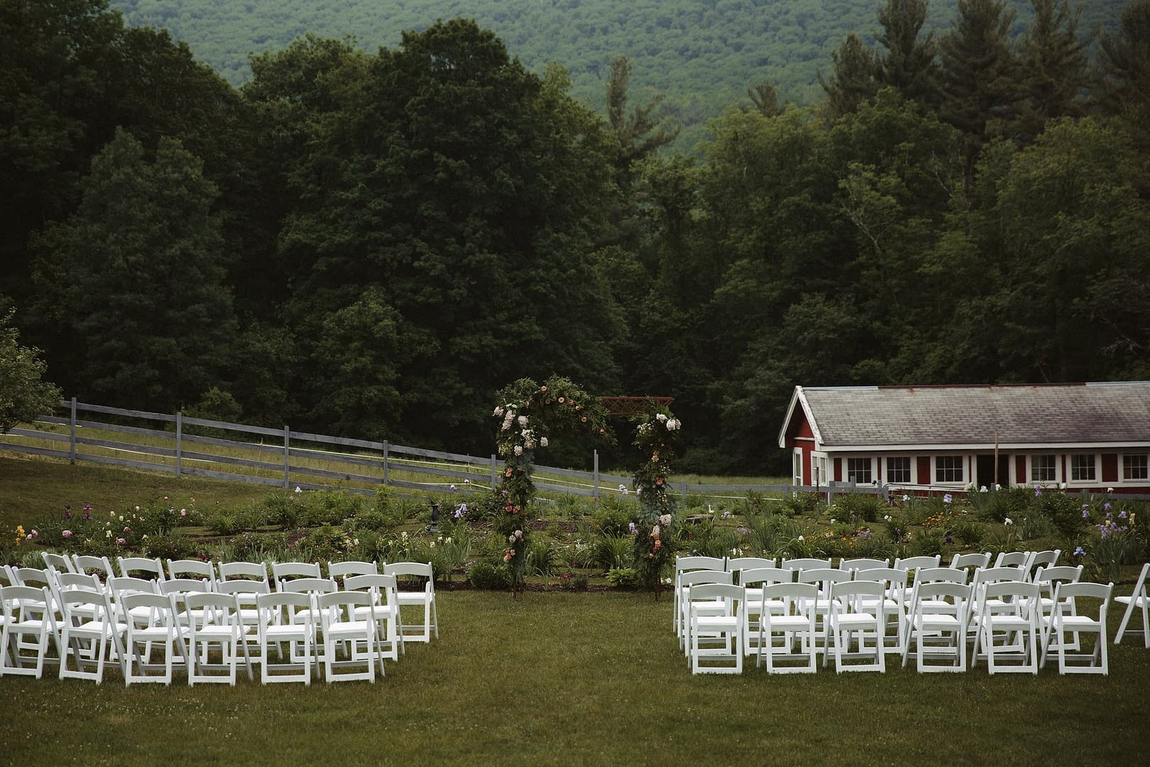 A lush summer arbor of June flowers in a neutral color palette by Nectar and Root, Vermont wedding florist at West Mountain Inn in Arlington, Vermont.