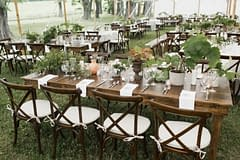 Neutral spring farm table centerpieces by Nectar and Root, Vermont wedding florist at Shelburne Museum in Shelburne, Vermont.
