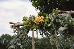 A simple summer arbor of July flowers in a neutral color palette by Nectar and Root, Vermont wedding Florist at Riverside Farm in Pittsfield, Vermont.
