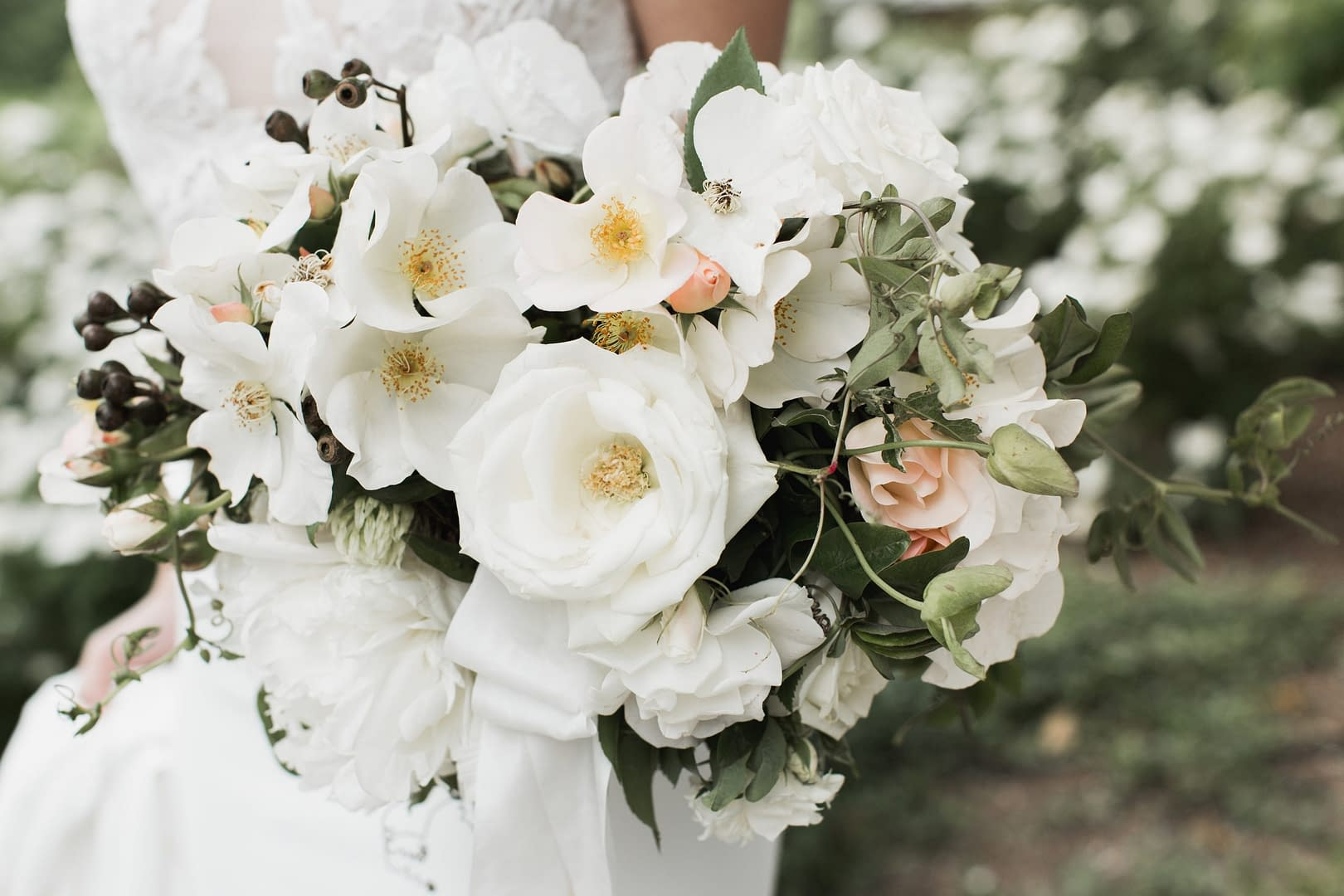Spring green, peach and white bridal bouquet by Nectar and Root, Vermont wedding florist at Shelburne Museum in Shelburne, Vermont.