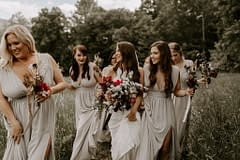 Boho summer bridesmaids bouquets of peonies, roses, tulips, and other June summer flowers in dusty neutral colors for outdoor micro wedding by Nectar and Root, Vermont wedding florist at a backyard wedding in Vermont.