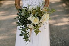A modern fall bridal bouquet of September flowers in a neutral color palette by Nectar and Root, Vermont wedding florist at Coach Barn at Shelburne Farms in Shelburne, Vermont.