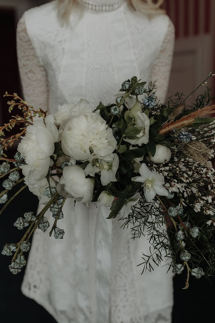 A lush spring bridal bouquet of March flowers in a neutral color palette by Nectar and Root, Vermont wedding florist at The Inn at Shelburne Farms in Shelburne, Vermont.
