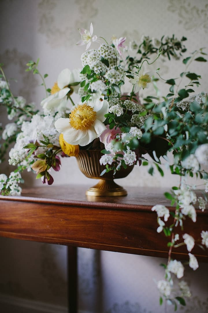Yellow, green and white centerpiece by Nectar and Root, Vermont wedding florist at Shelburne Coach Barn in Shelburne, Vermont.
