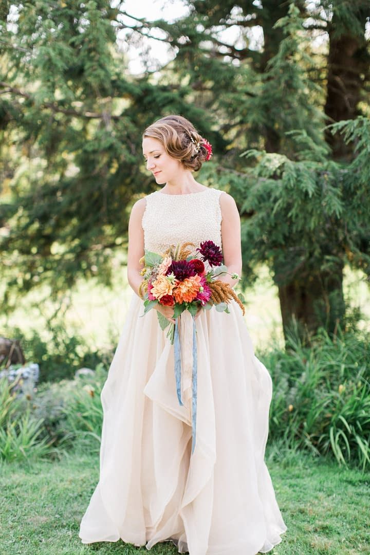 A modern fall bridal bouquet of September flowers in a moody color palette by Nectar and Root, Vermont wedding florist at Stowehof Inn in Stowe, Vermont.
