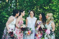 A modern summer bridal bouquet of June flowers in a neutral color palette by Nectar and Root, Vermont wedding florist at Alerin Barn in Saint Johnsbury, Vermont.