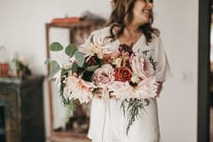 Boho fall micro wedding bridal bouquet featuring September ferns, garden roses, cafe au lait dahlias, eucalyptus, and blushing bride protea in dark palette by Nectar and Root, Vermont wedding florist at Foxfire Mountain House in Catskills, New York.