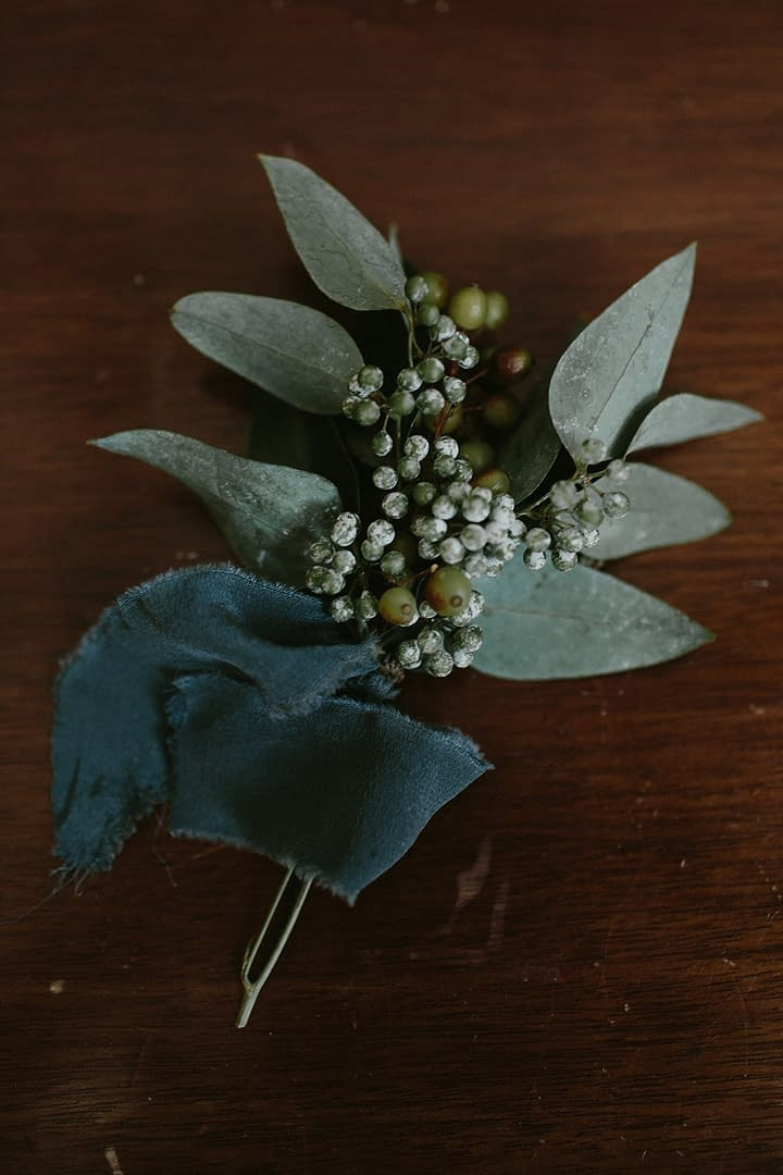 A simple fall boutonniere of September flowers in a neutral color palette by Nectar and Root, Vermont wedding florist at Coach Barn at Shelburne Farms in Shelburne, Vermont.