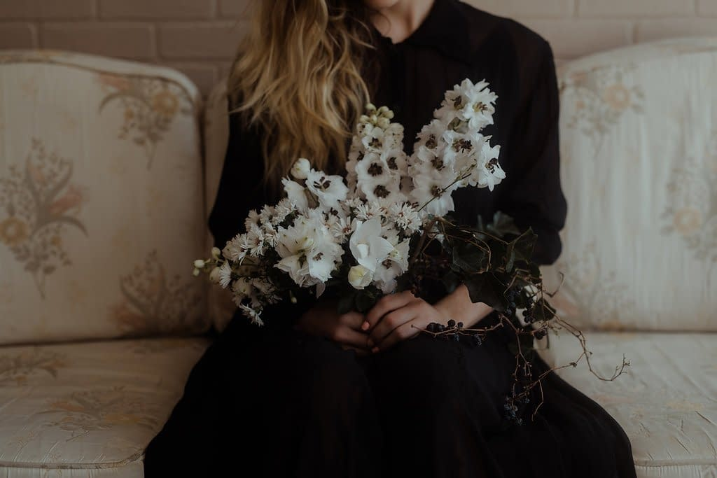 A simple fall bridal bouquet of November flowers in a moody color palette by Nectar and Root, Vermont wedding florist at Nectar and Root Studio in Winooski, Vermont.