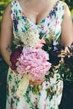 A modern summer bridesmaid bouquet of June flowers in a neutral color palette by Nectar and Root, Vermont wedding florist at Alerin Barn in Saint Johnsbury, Vermont.