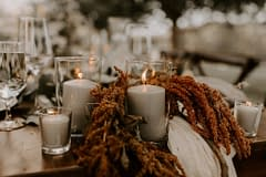 Outdoor elopement summer candlelit June reception centerpiece with amaranth by Nectar and Root, Vermont wedding florist at a backyard wedding in Vermont.