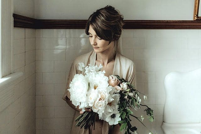 A romantic spring bridal bouquet of May peonies, anemones, garden roses and sweet peas in a blush and white palette by Nectar and Root, a Vermont wedding florist.