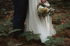 A simple summer bridal bouquet of June flowers in a neutral color palette by Nectar and Root, Vermont wedding florist at West Mountain Inn in Arlington, Vermont.