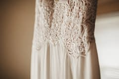 Micro wedding details featuring a modern beaded wedding dress inspired by Nectar and Root, Vermont wedding florist at Foxfire Mountain House in Catskills, New York.