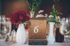 A modern summer reception centerpiece of June flowers in a neutral color palette by Nectar and Root, Vermont wedding florist at Alerin Barn in Saint Johnsbury, Vermont.