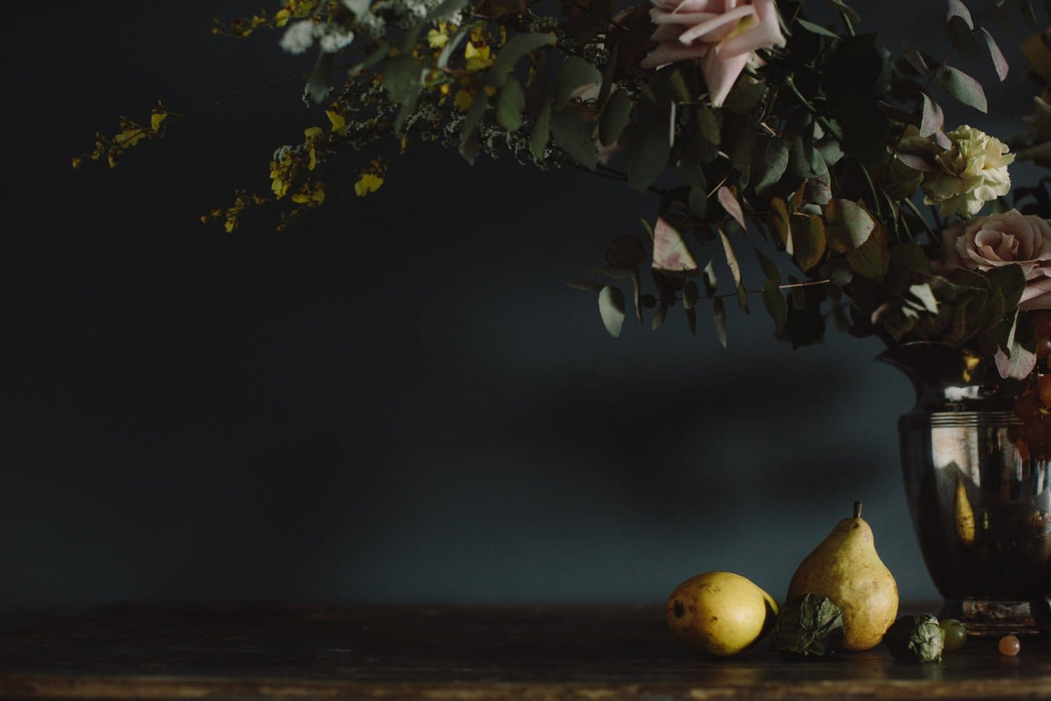 A modern spring reception centerpiece of March flowers in a moody color palette by Nectar and Root, Vermont wedding florist in Brooklyn, New York.