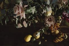A lush spring reception centerpiece of March flowers in a moody color palette by Nectar and Root, Vermont wedding florist in Brooklyn, New York.