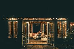 Intimate modern outdoor micro wedding lounge area with details by Nectar and Root, Vermont wedding florist at Foxfire Mountain House in Catskills, New York.
