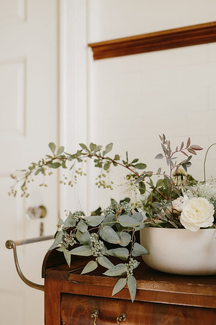A modern fall floral accent of September flowers in a neutral color palette by Nectar and Root, Vermont wedding florist at Coach Barn at Shelburne Farms in Shelburne, Vermont.